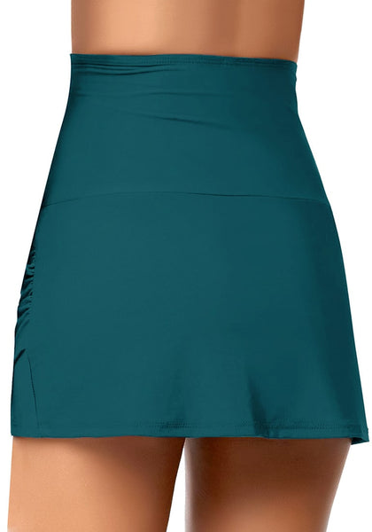 Back view of model wearing teal tulip hem high waist ruched swim skirt