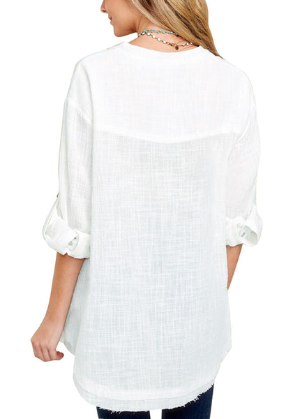 Back view of model wearing white  V-neckline roll-tab sleeves loose tunic top