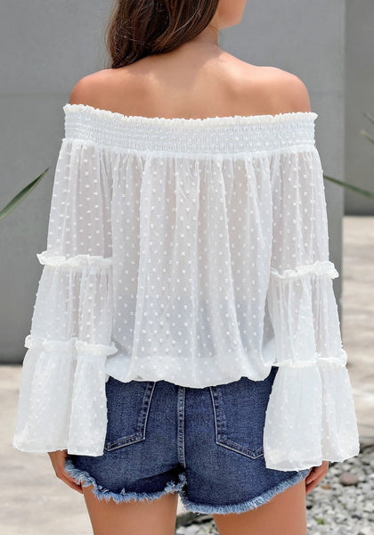 Back view of model wearing white bell sleeves dotted loose off-shoulder top