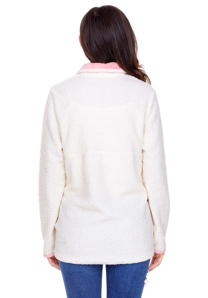 Back view of model wearing white button-front fleece pullover