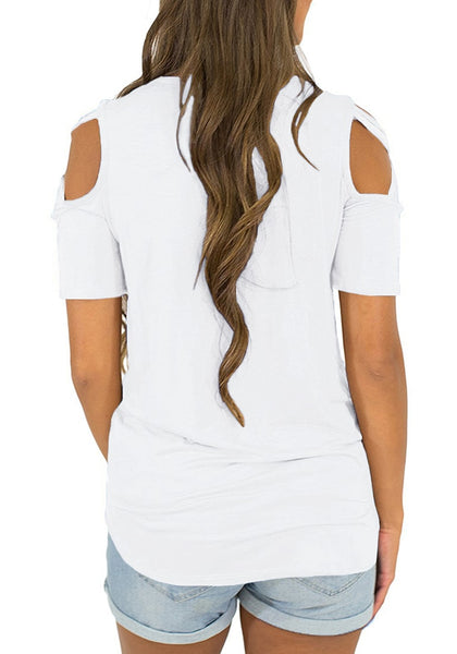 Back view of model wearing white cisscross cutout shoulder blouse