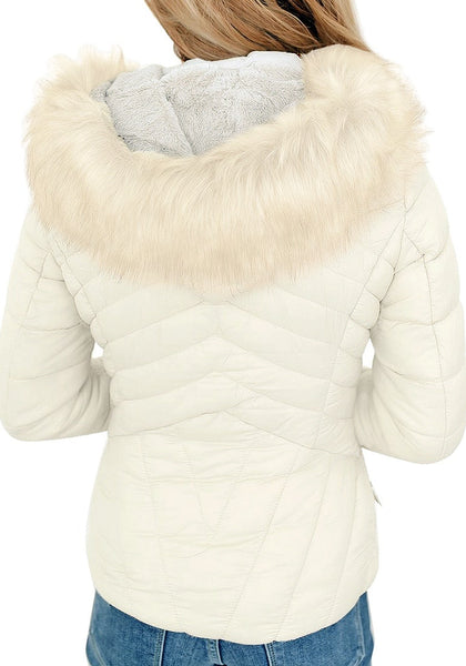 Back view of model wearing white faux-fur hood zip-up quilted jacket