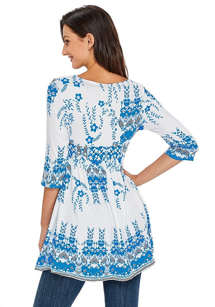Back view of model wearing white floral-print flowy tunic