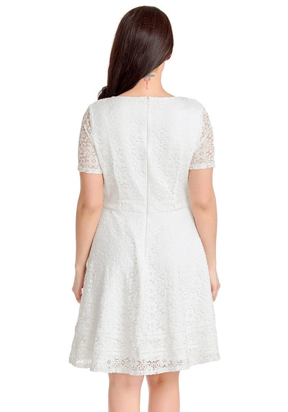 Back view of model wearing white floral hollow lace short sleeves skater dress