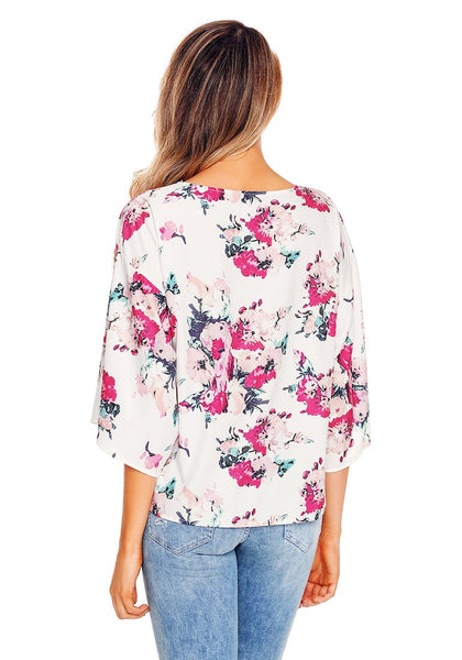 Back view of model wearing white floral print tie front chiffon blouse.