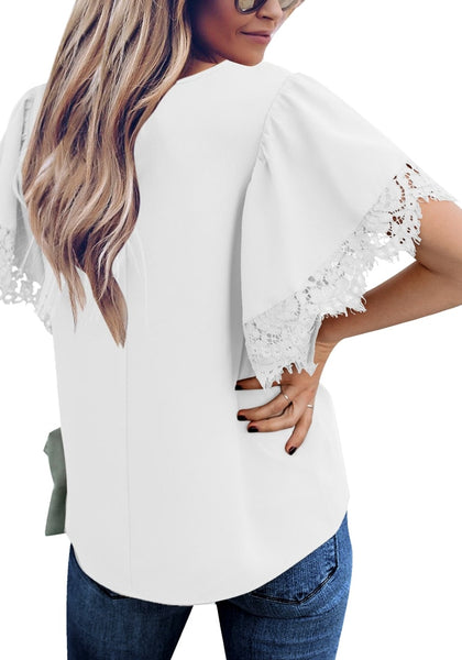 Back view of model wearing white flutter sleeves lace trim loose blouse