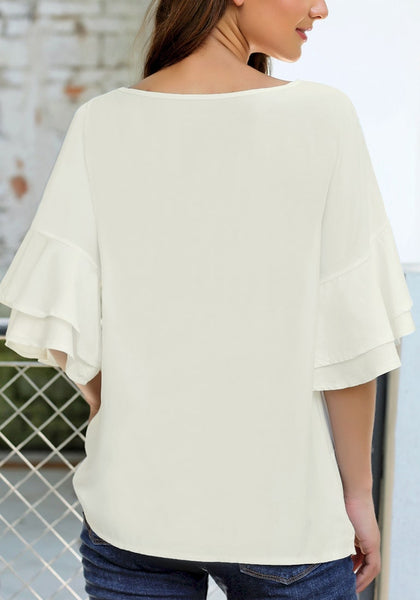 Back view of model wearing white layered flared sleeves twist-knot loose top
