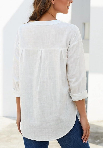 Back view of model wearing white notched henley cuffed sleeves blouse