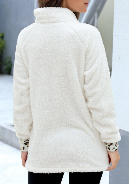 Back view of model wearing white oblique stand collar leopard fleece pullover