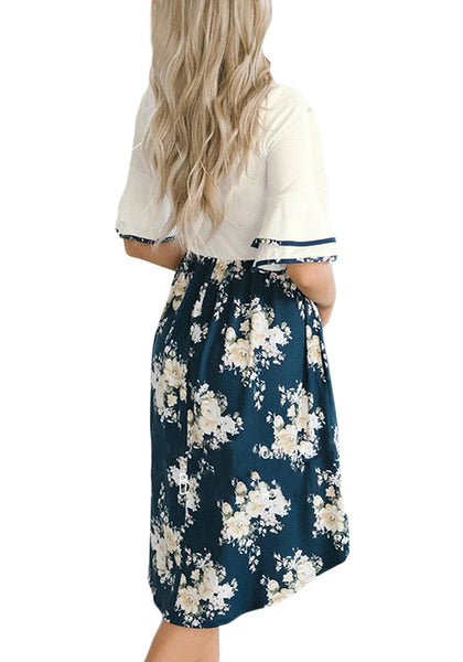 Back view of model wearing white ruffle sleeves floral midi dress