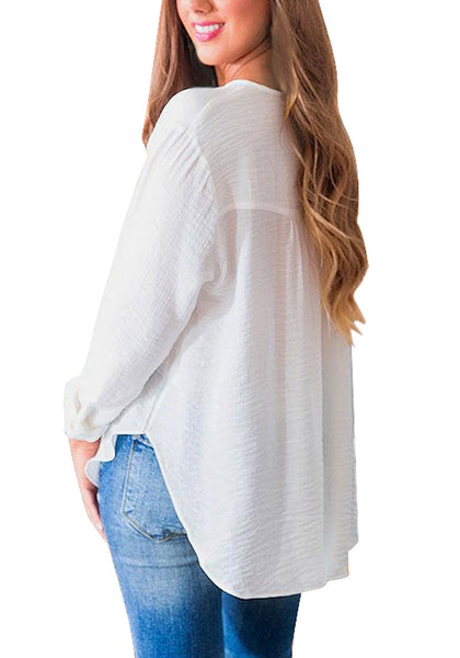 Back view of model wearing white slit V-neckline long sleeves flowy tunic top