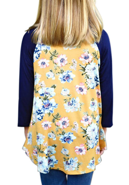 Back view of model wearing yellow floral print raglan sleeves girl tunic for her
