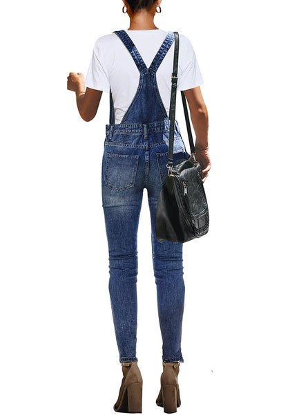 Back view of modell wearing dark blue ripped skinny jeans denim bib overall