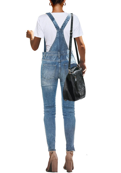 Back view of modell wearing light blue ripped skinny jeans denim bib overall