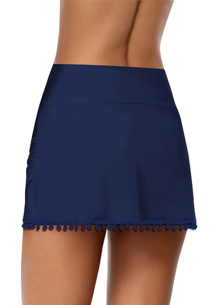 Back view of navy tulip hem tassels mid-waist ruched swim skirt