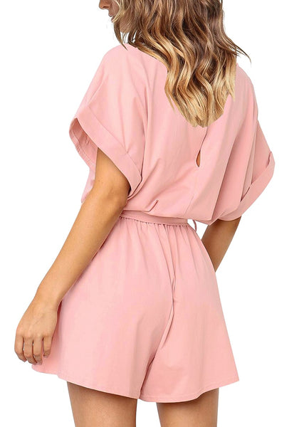 Back view of pretty model wearing light pink elastic-waist short sleeves belted loose romper