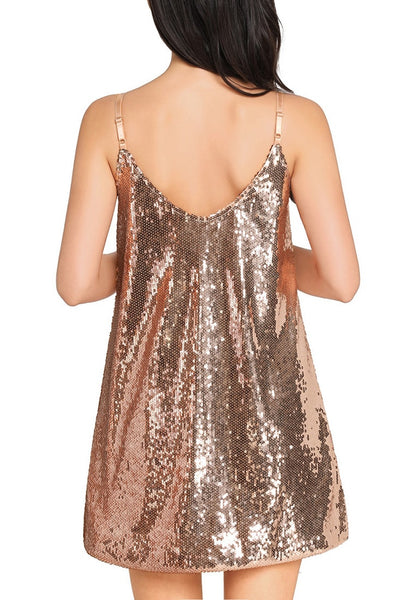 Back view of sexy model in champagne sequins slip dress