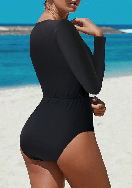 Back view of sexy model wearing black cutout lace-up one-piece rash guard swimsuit