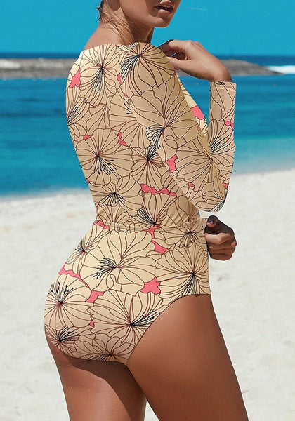 Back view of sexy model wearing tan cutout lace-up one-piece rash guard swimsuit