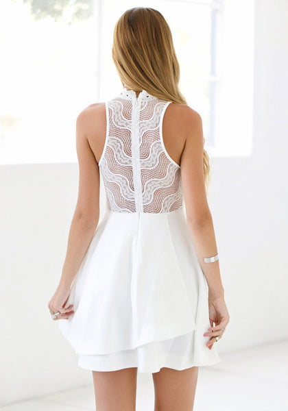 Back view of white lace illusion neck dress
