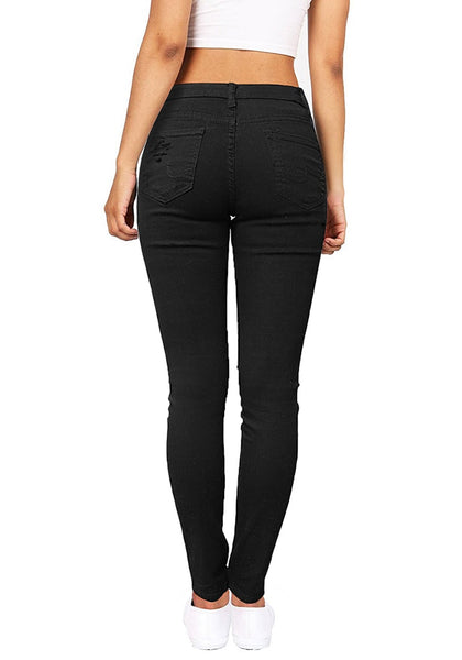 Back view of woman in black distressed skinny jeans