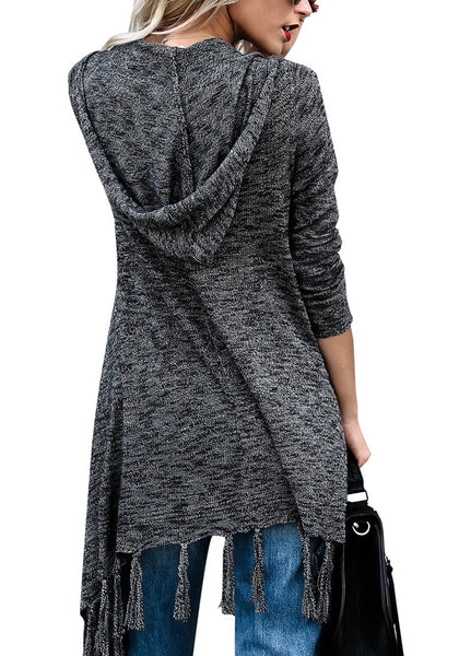 Back view of woman in black long sleeves knitted open front tassel cardigan