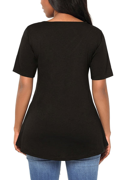 Back view of woman in black strappy V-neck blouse