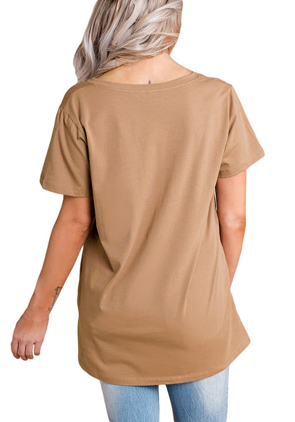 Back view of woman in camel cutout side-slit blouse