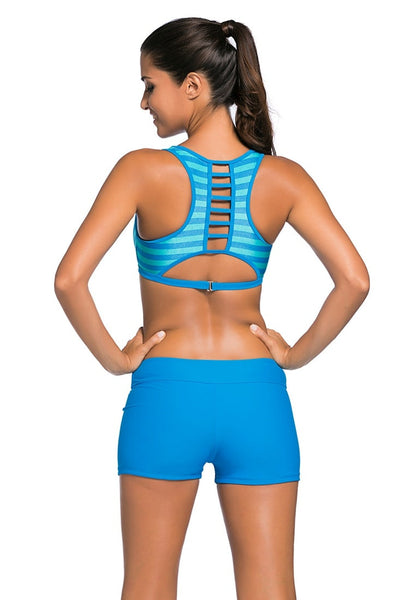 Back view of woman in light striped sports bra two-piece set