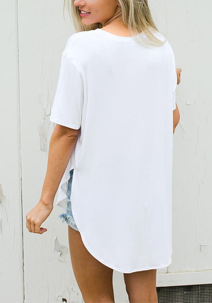 Back view of woman in white curved hem classic tee