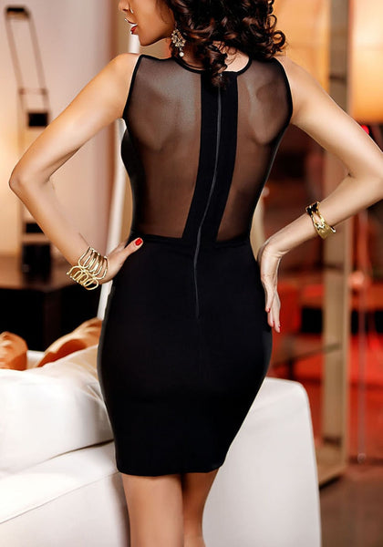 Back view of woman wearing black illusion-neck rhinestone mini dress