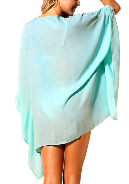 Back view of woman wearing mint lace-up batwing sleeves beach cover-up