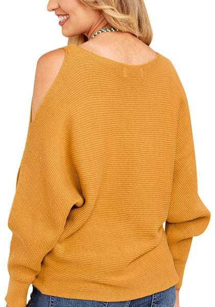Back view of woman wearing mustard yellow cutout slit sweater