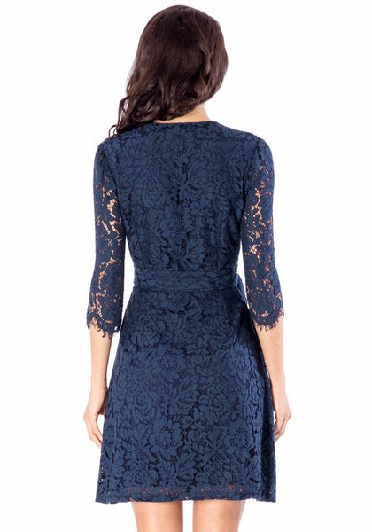 Back view of woman wearing navy floral lace overlay wrap dress