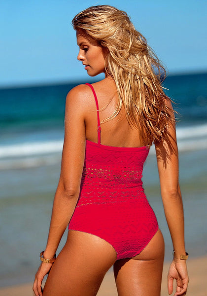 Backside shot of blonde model in a red lace halter swimsuit