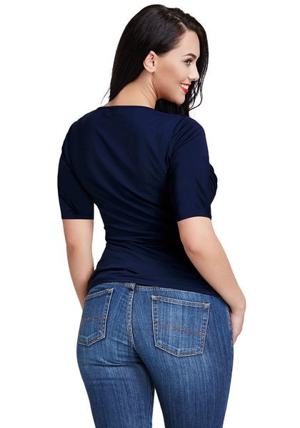Backside view of a model wearing a navy blue ruched surplice top