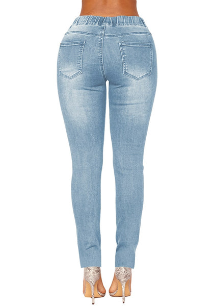 Back view of light blue drawstring-waist washout ripped skinny jeans