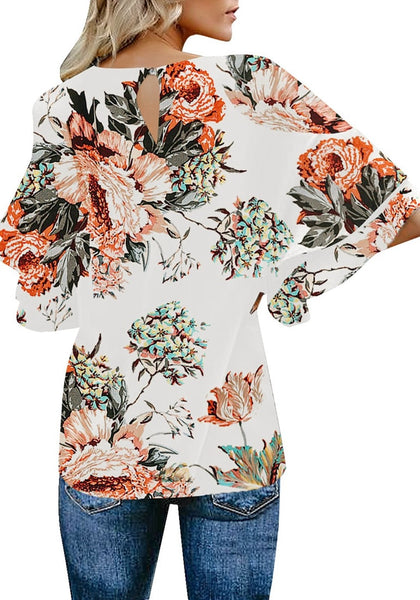 Back view of model in apricot trumpet sleeves keyhole-back printed blouse