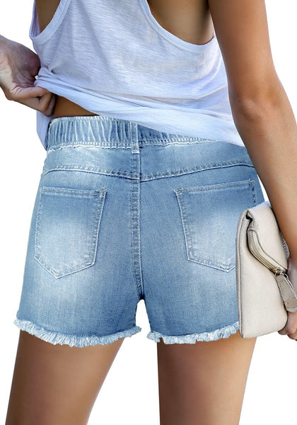 Back view of model poses wearing a light blue drawstring-waist raw he ripped shorts