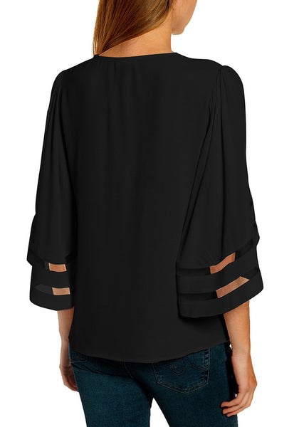 Back view of model wearing black 34 bell mesh panel sleeves V-neckline embroidered top