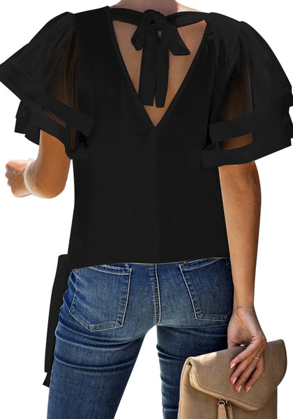 Back view of a girl wearing black V-back mesh butterfly sleeves side-tie wrap top