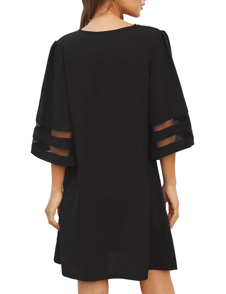 Back view of model wearing black V-neck 34 bell sleeves button down shift dress
