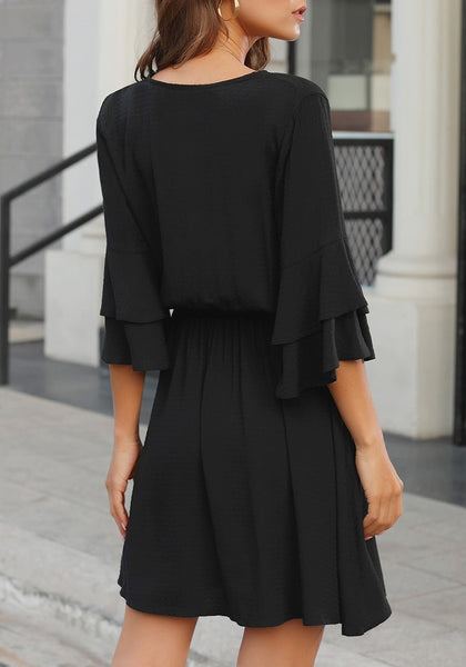 Back view of model wearing black V-neckline elastic waist layered bell sleeves dress