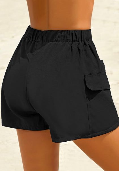 Back view of model wearing black elastic-waist side pockets lace-up board shorts