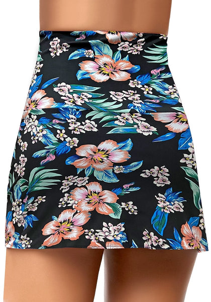 Back view of model wearing black floral-print high-waist tulip hem ruched swim skirt