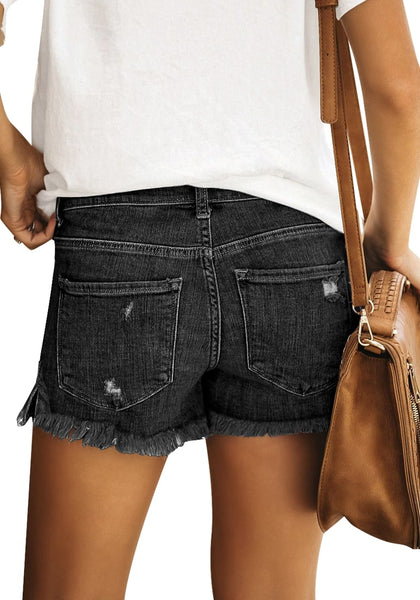 Back view of model wearing black frayed hem distressed side-slit denim shorts