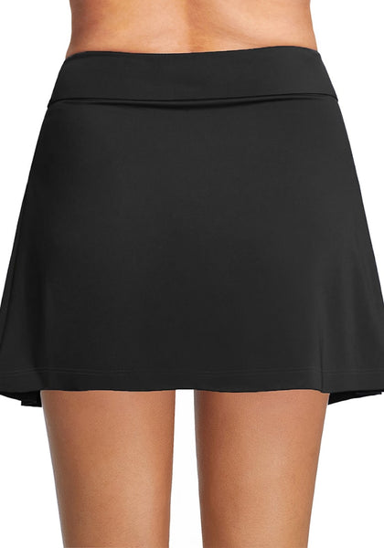Back view of model wearing black pleated side mid-waist swim skirt