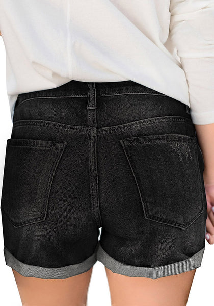 Back view of model wearing black roll-over hem button-up ripped denim shorts