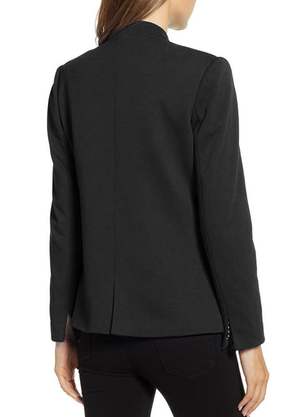 Back view of model wearing black single button inverted lapel flap pockets blazer