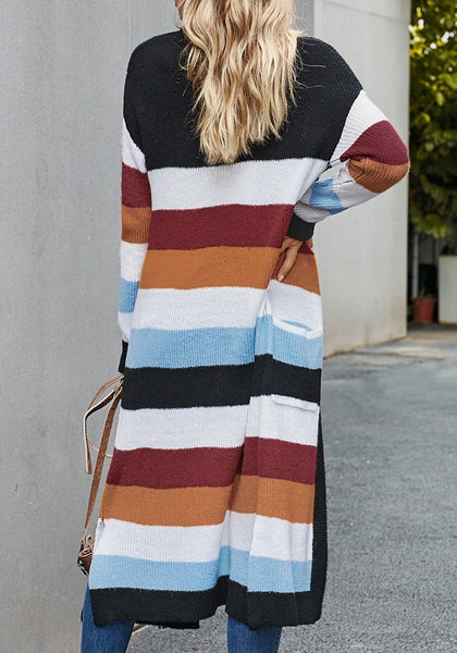 Back view of model wearing black striped colorblock open-front knit maxi cardigan